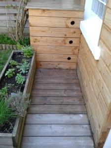saturateur incolore sur terrasse en bois